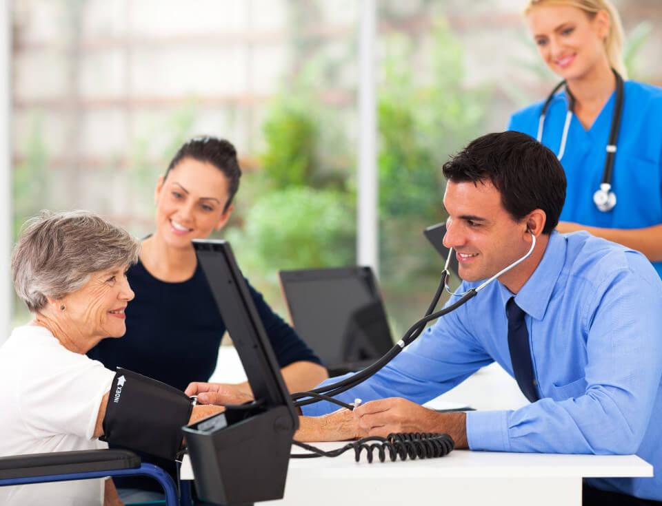 Doctor-checking-senior-min